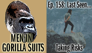 A woman standing on the edge of a cliff - Men in Gorilla Suits Ep. 158: Last Seen…Taking Risks